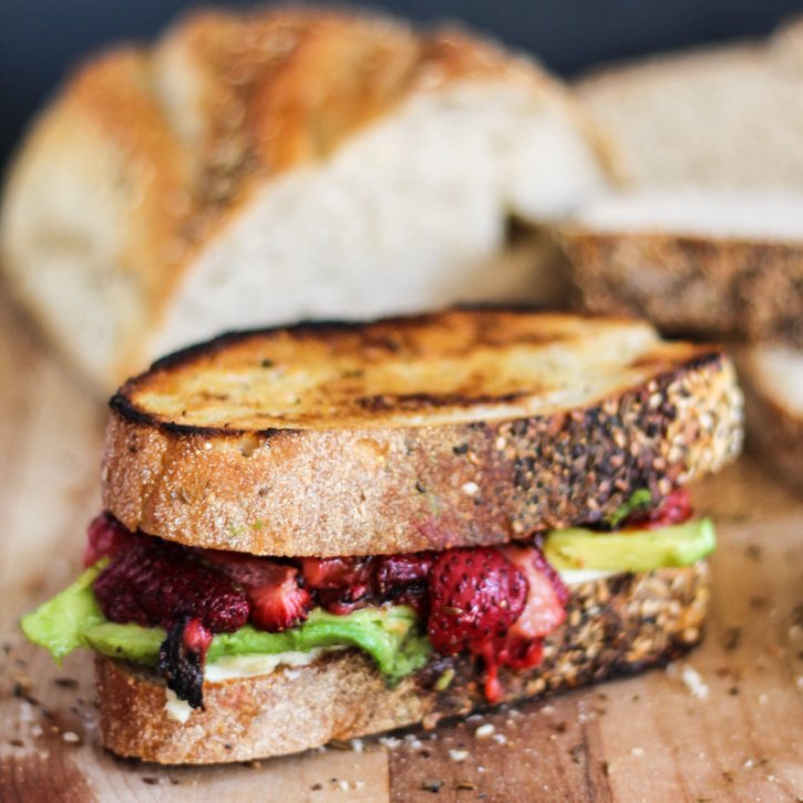 Delicious dairy free grilled cheese with juicy roasted strawberries and ripe avocado. You need this in your life.