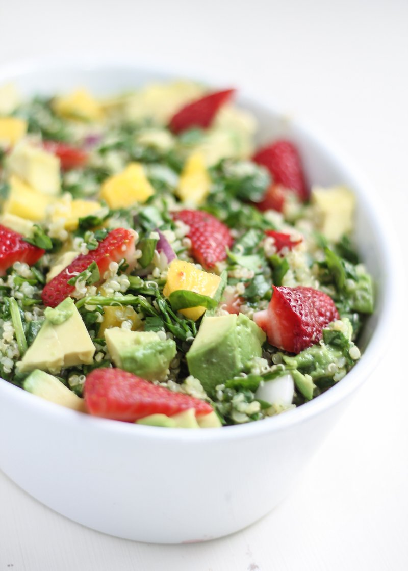 Nutritious And Flavorful Spinach Quinoa Salad Bursting With Mango Strawberries Avocado And A Scrumptious