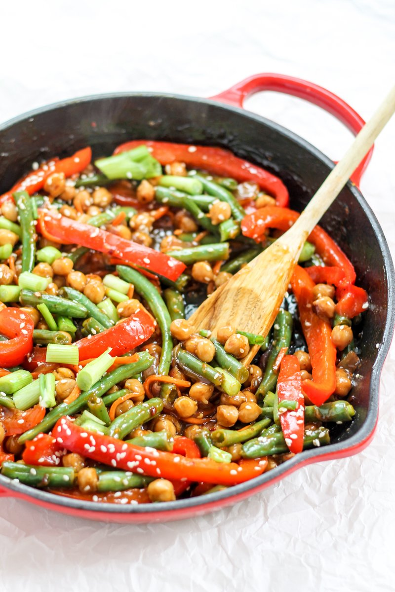Healthy Sesame-Ginger Orange Chickpea Stir-Fry loaded with veggies. This is a healthier, vegetarian version of your favorite take-out! Serve over quinoa or brown rice for a full, protein-packed meal. Vegan-friendly.