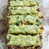 meatless black bean loaf topped with avocado sauce