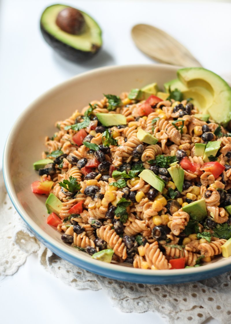 southwest pasta salad with beans, avocado, and vegetables