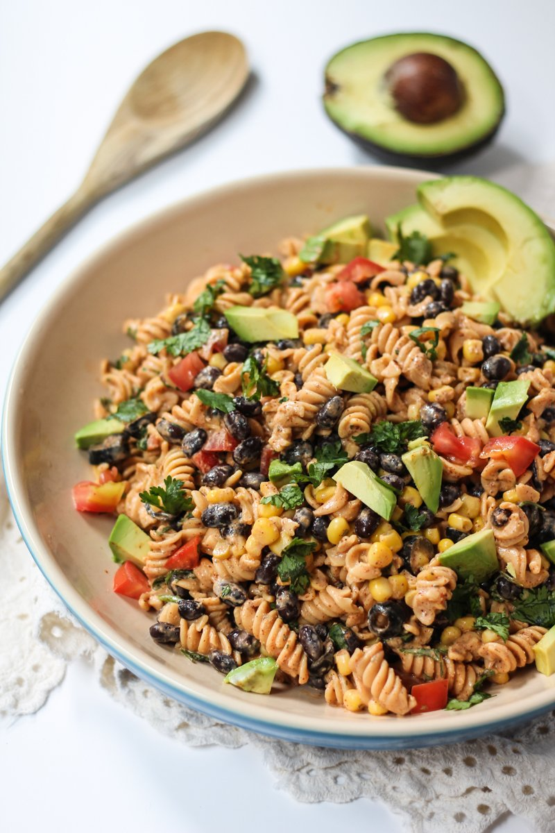 southwest pasta salad recipe in a bowl with avocados