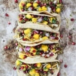lentil tacos with mango, pomegranate, onion, and cilantro