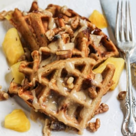 carrot cake waffles on plate with maple glaze