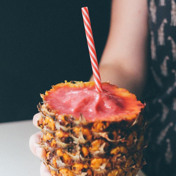 watermelon pineapple smoothie served in a pineapple