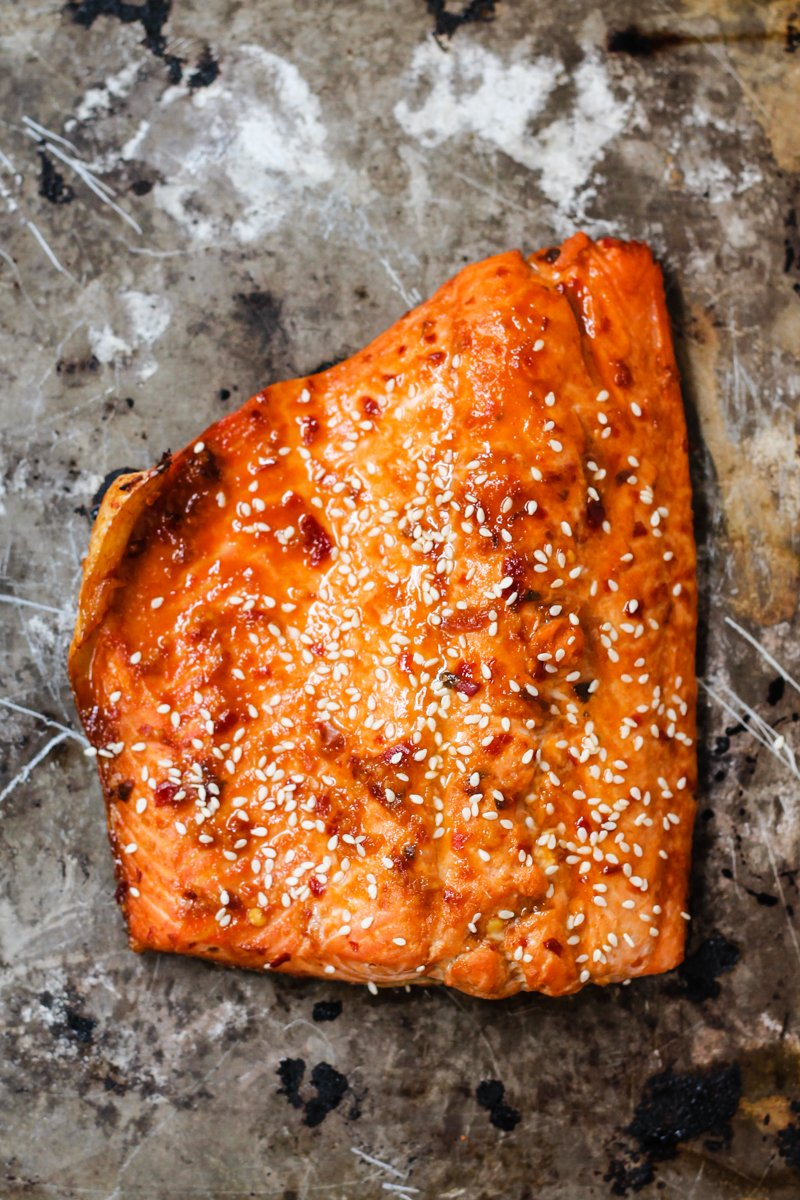 piece of sriracha salmon with sesame seeds