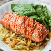 A healthy honey marinated sriracha salmon served over a delicious spiralized sesame cucumber noodle salad!