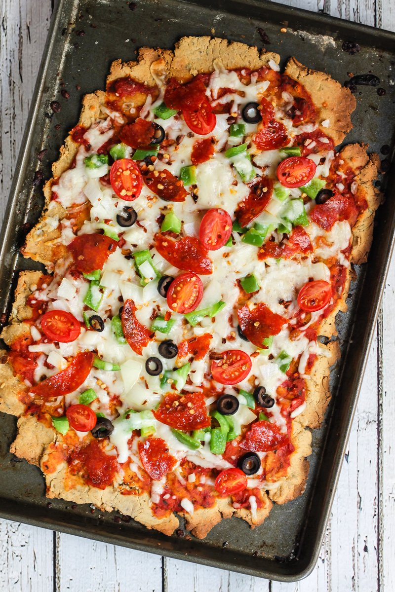 A delicious quinoa pizza crust made with quinoa flour! Topped with delicious toppings like mozzarella cheese, peppers, onions, olives and pepperoni.