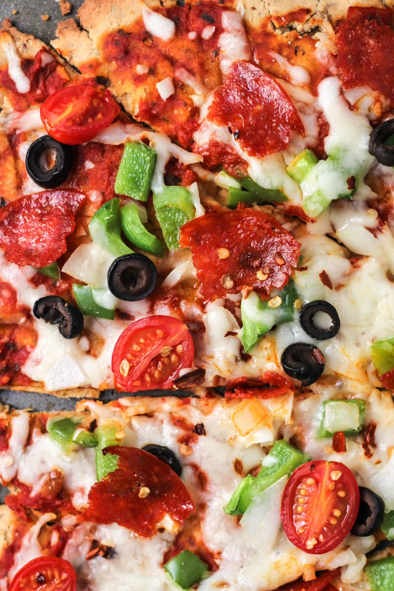A delicious, healthy quinoa pizza crust made with quinoa flour! Topped with delicious toppings like mozzarella cheese, peppers, onions, olives and pepperoni.
