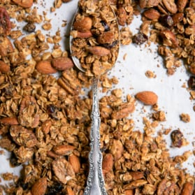 coconut oil granola on pan with spoon