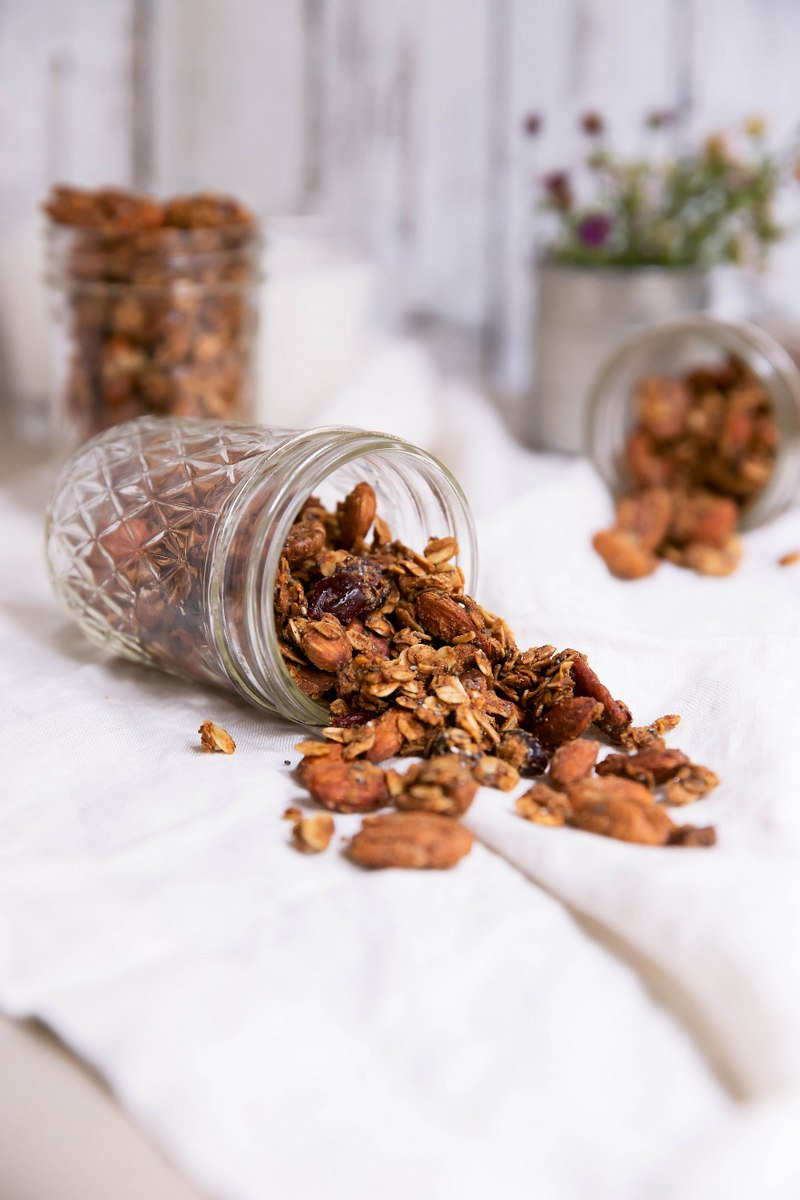 coconut oil granola spilling out of mason jar