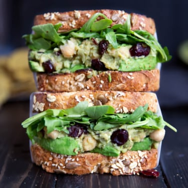 stack of chickpea avocado salad sandwich