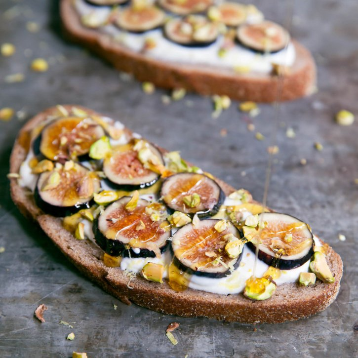 Delicious breakfast toast topped with a honey-lemon whipped ricotta, figs and pistachios.