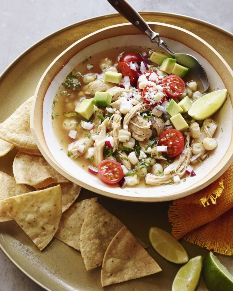 bowl of chicken posole with tortilla chips