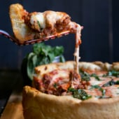 Outrageous AMAZING recipe for DEEP dish pizza with ooey-gooey cheese and a butter-cornmeal crust. MUST MAKE! #pizza #deepdish