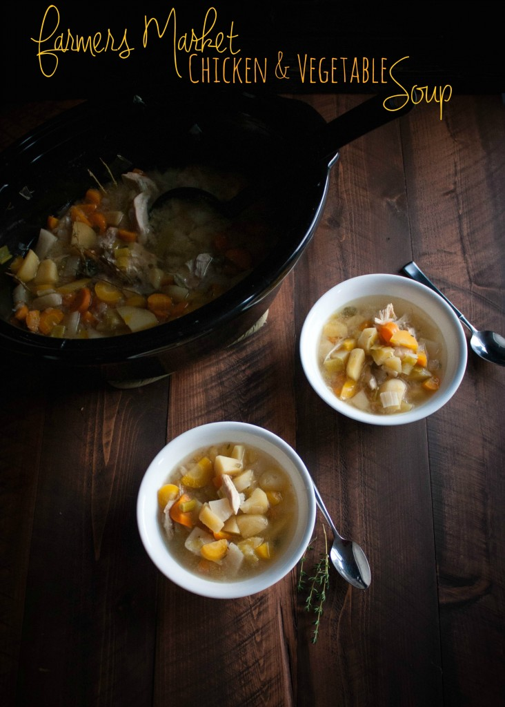 pot and bowls of chicken vegetable soup on table