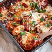 pan of sweet potato polenta bake with cheese and red chile sauce