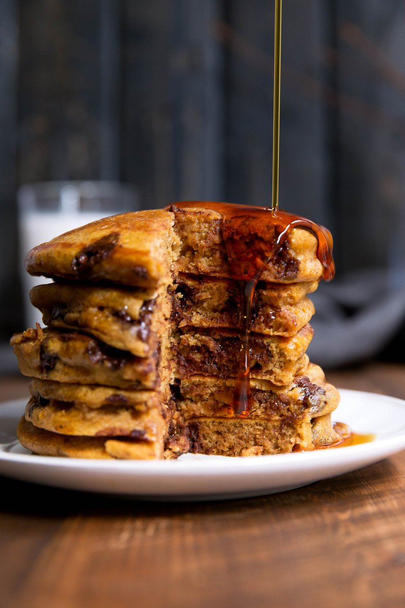whole wheat pumpkin chocolate chip pancakes on a plate