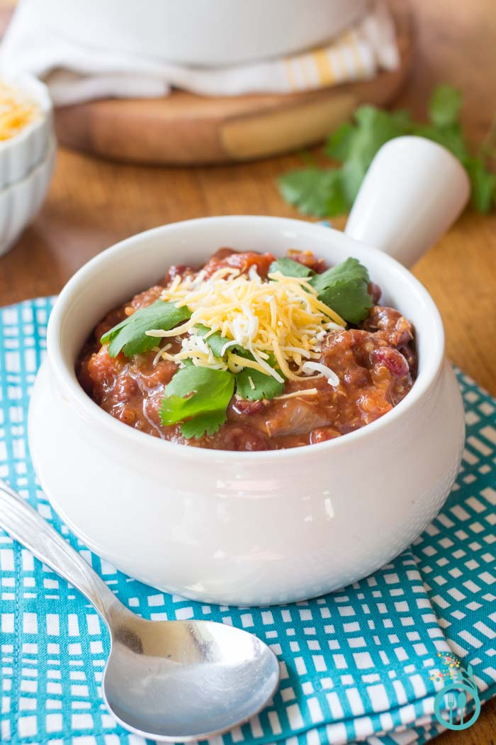 bowl of Vegetarian Quinoa Chili topped with cilantro and cheese