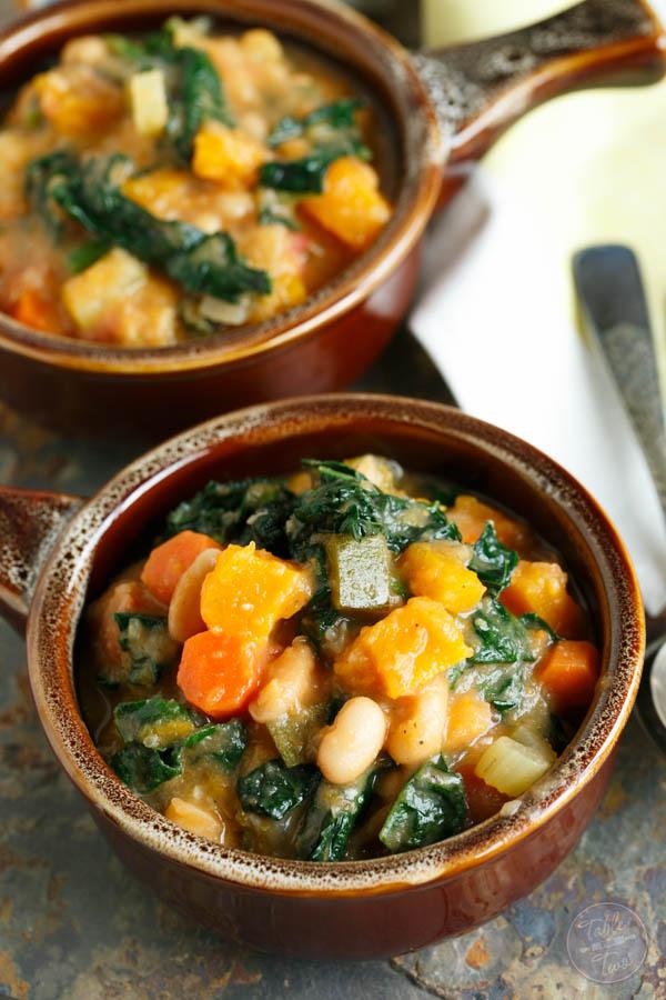 two bowls of butternut squash white bean kale stew