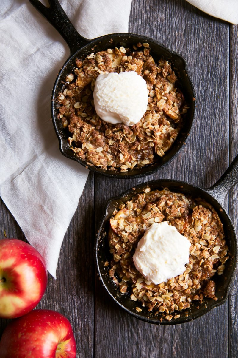 caramel apple crisps in iron skillets