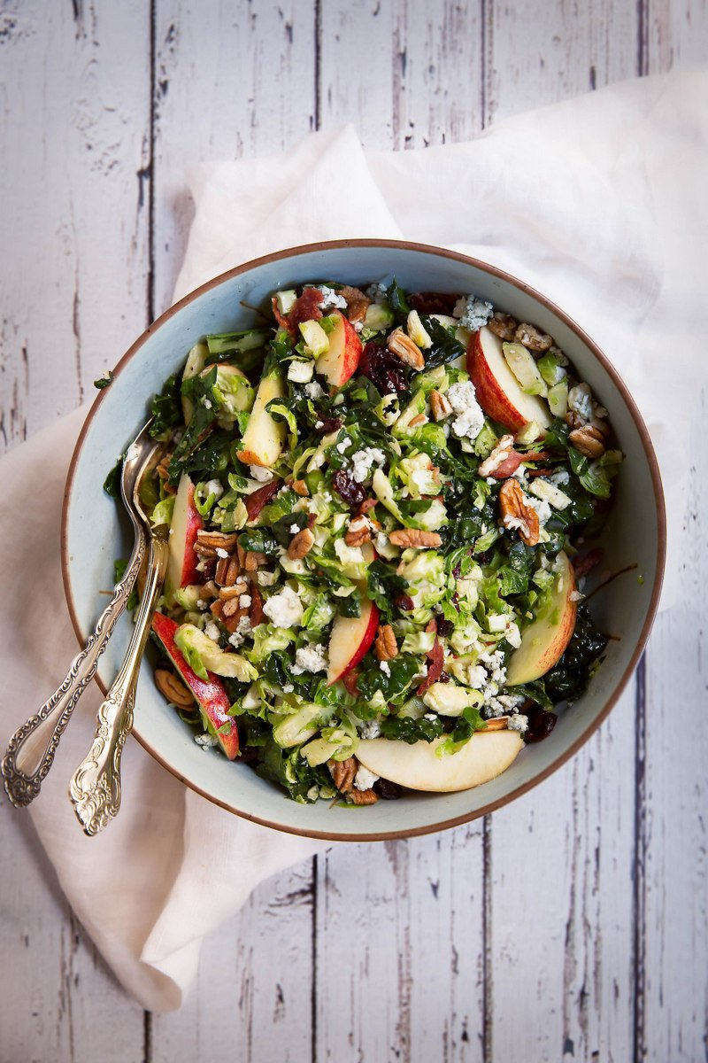 The BEST healthy apple recipes: brussels sprouts apple salad in a bowl with two spoons