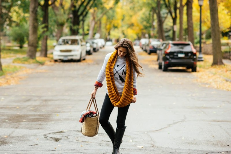 woman on street wearing yellow scarf