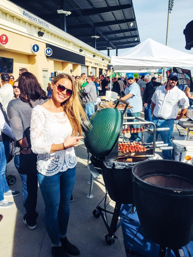 girl with smoker grill at outdoor festival