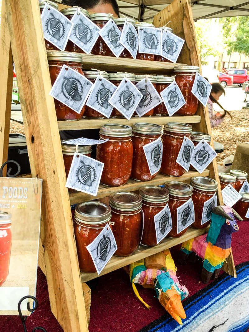 jars of homemade salsa at outdoor market