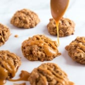 drizzling peanut butter glaze on apple oatmeal cookies