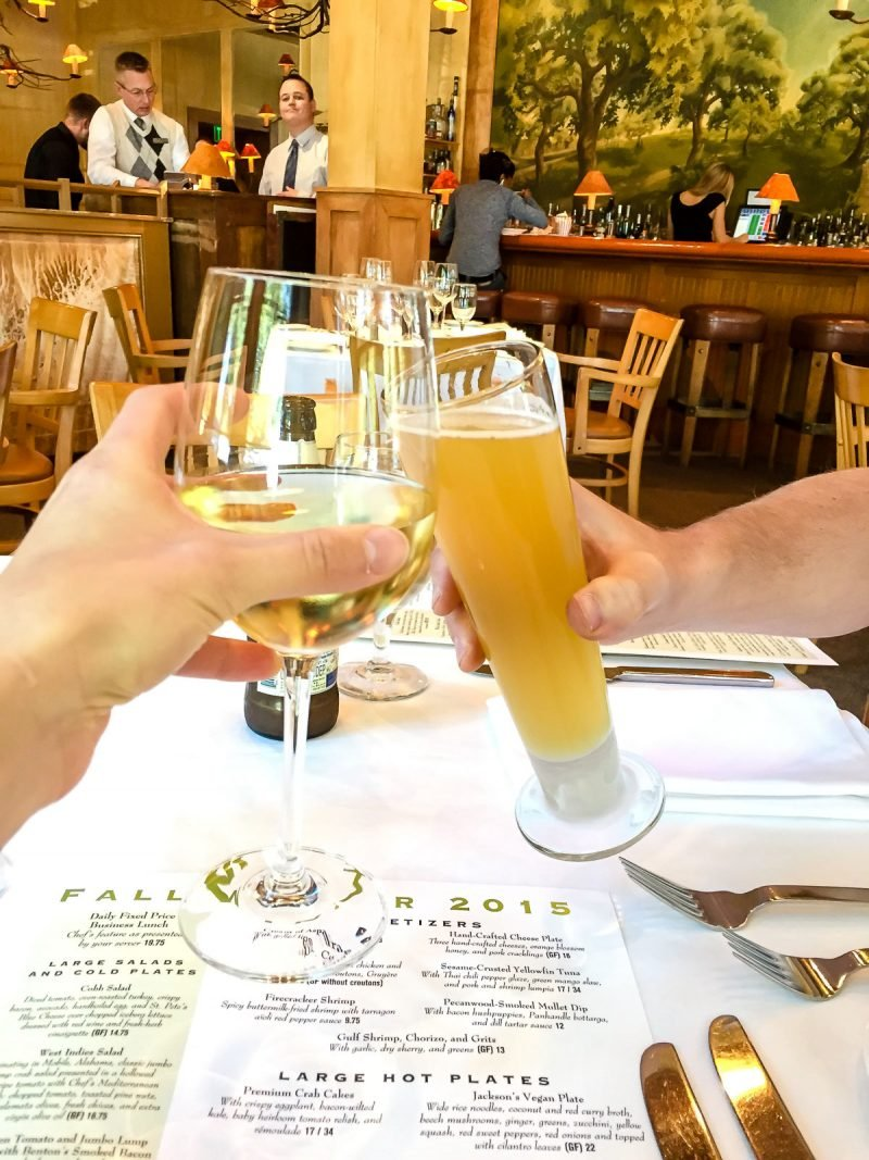 wine and beer glasses cheers at restaurant