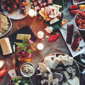table spread of snacks and food
