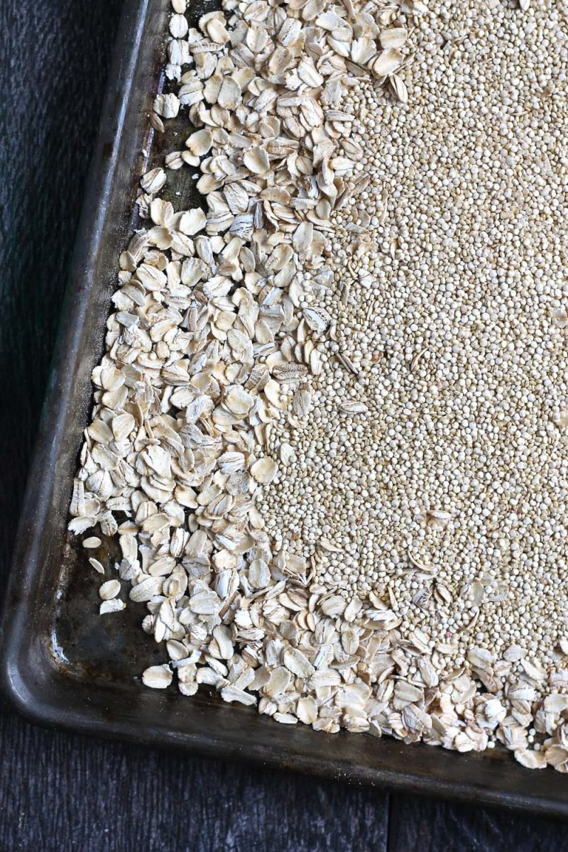 oats and quinoa on baking sheet