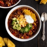 bowl of healthy turkey chili with toppings and tortilla chips