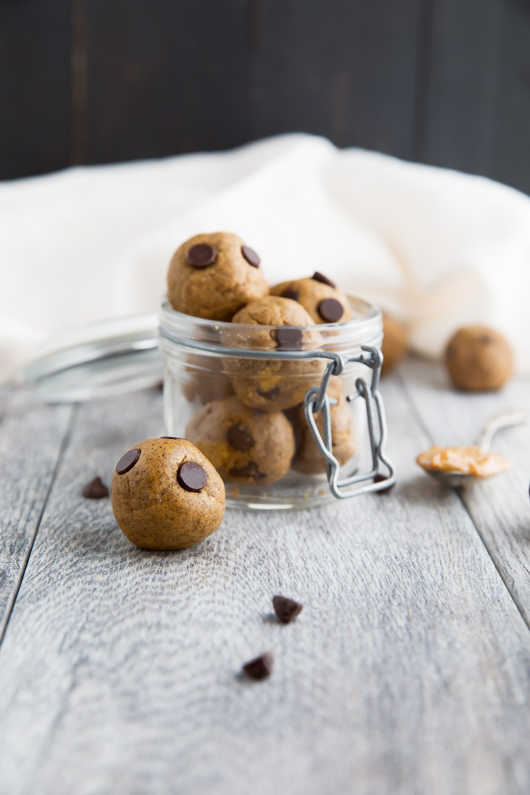 Healthy Protein-packed peanut butter balls that taste like a peanut butter cup cookie dough. No sugar added, grain free, gluten free and over 5g protein per ball! | ambitiouskitchen.com