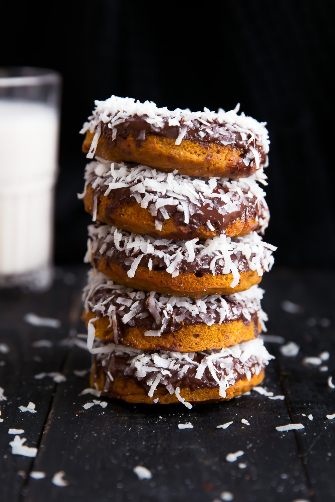 Sweet Potato Donuts with Dark Chocolate and coconut in a stack