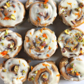 Whole Wheat Chocolate Cinnamon Rolls with orange icing and pistachios