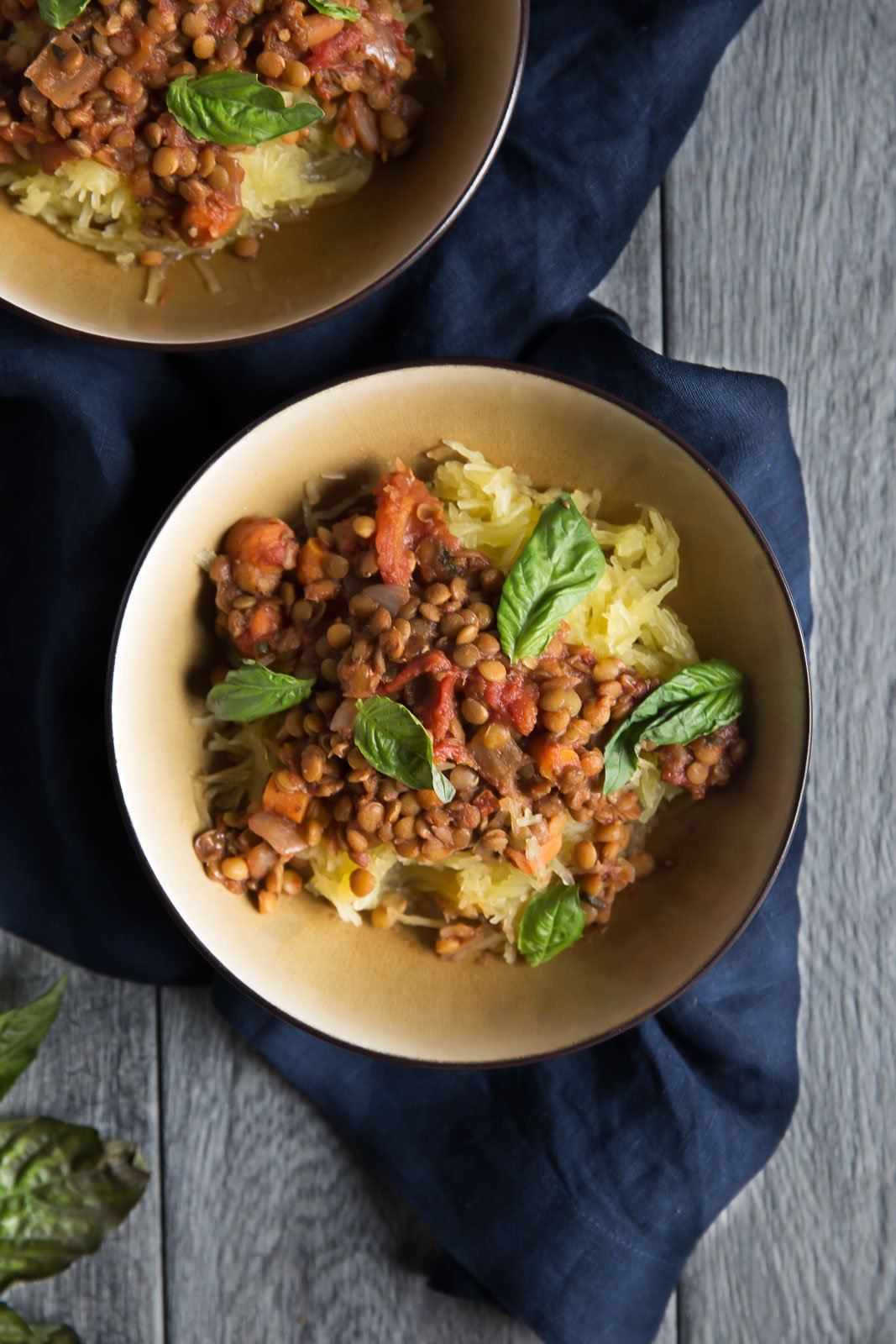 lentil sloppy joes over spaghetti squash in a bowl