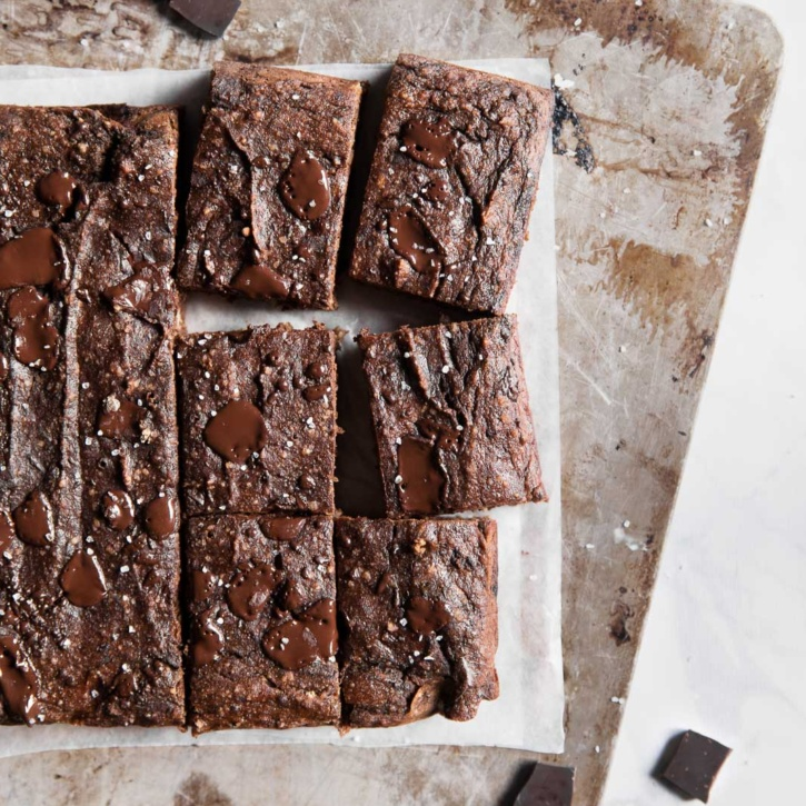 Incredible double chocolate paleo banana bread bars made with almond and coconut flour. NO SUGAR ADDED - a great healthy treat!