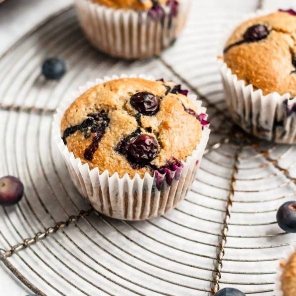 healthy blueberry oatmeal muffins on a round wire rack