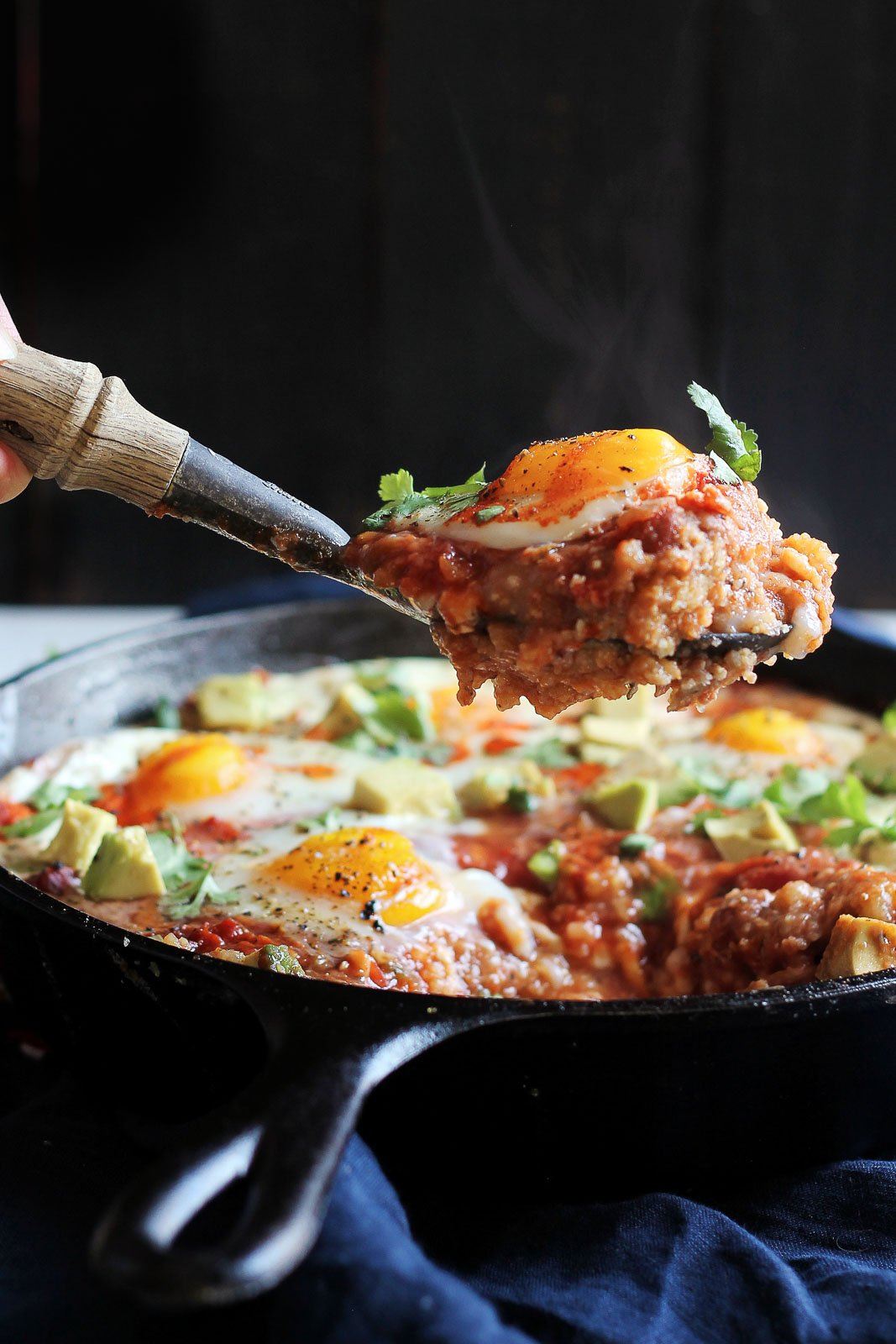 polenta egg skillet bake lifted with a spoon