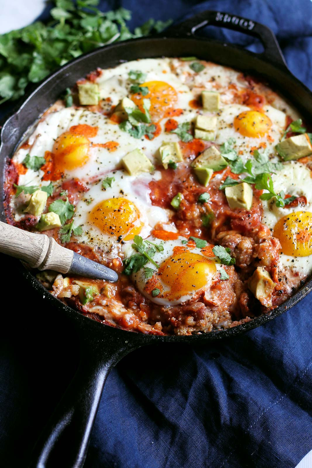 one pan meals: eggs and polenta in a skillet with a spoon
