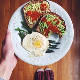 avocado toast with eggs and asparagus on a plate
