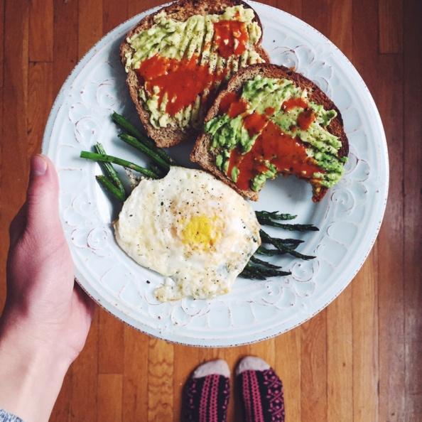 avocado toast with eggs and asparagus on a plate