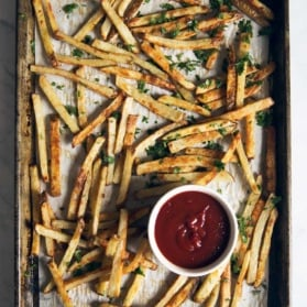 Healthy Baked Crispy French Fries with garlic, parmesan and truffle oil! Taste like your favorite from a restaurant!