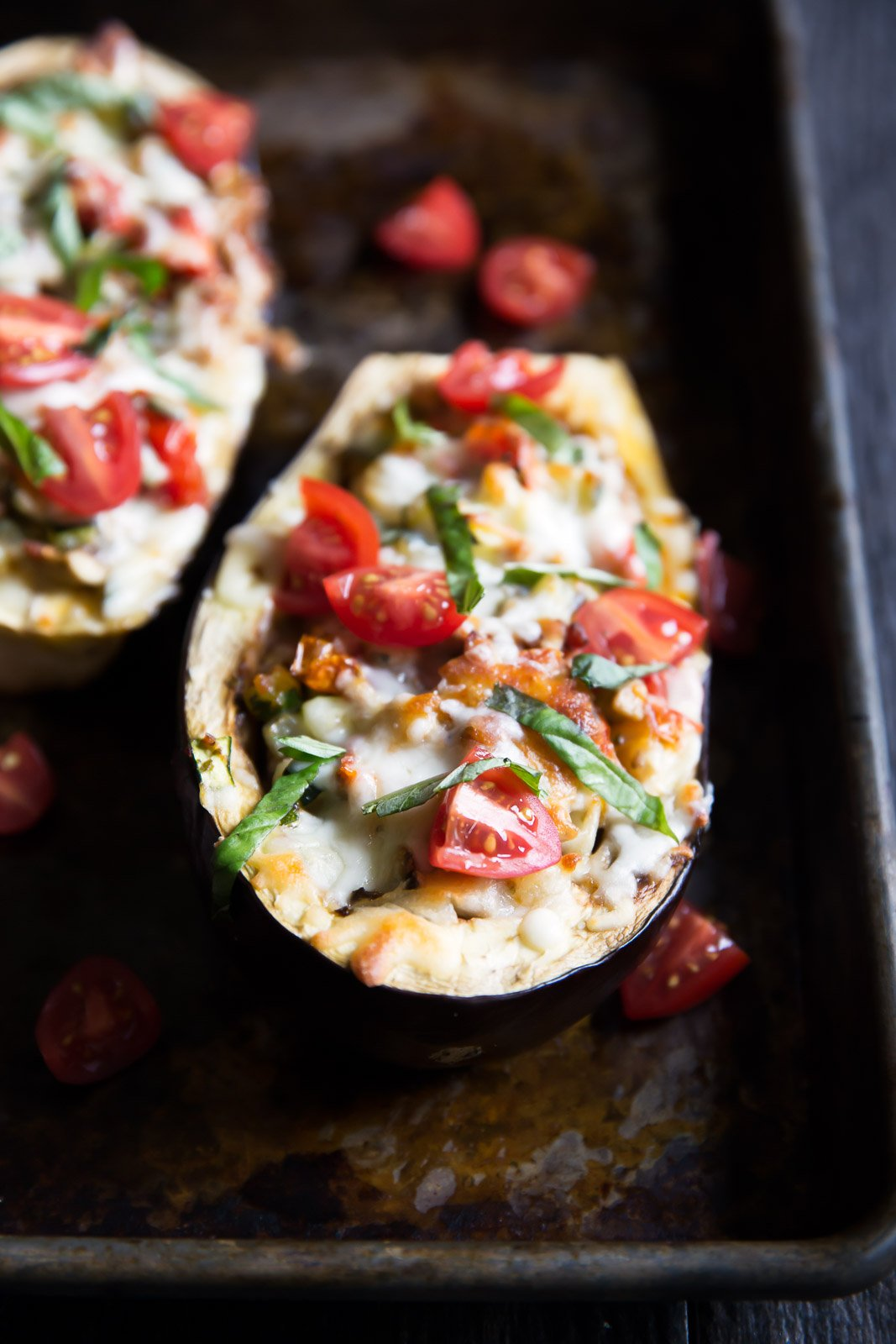 stuffed eggplant boats on a baking sheet
