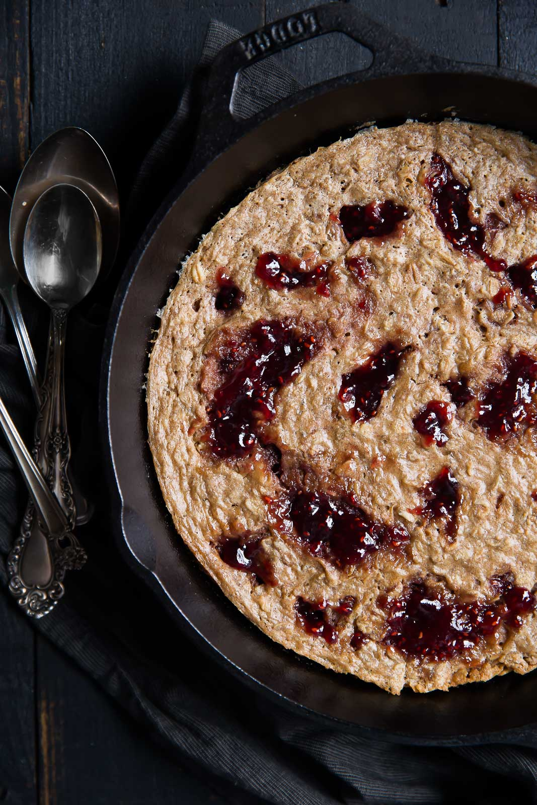 peanut butter and jelly baked oatmeal in a skillet