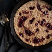 peanut butter and jelly oatmeal bake in a skillet