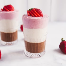 banana split smoothie in two glasses