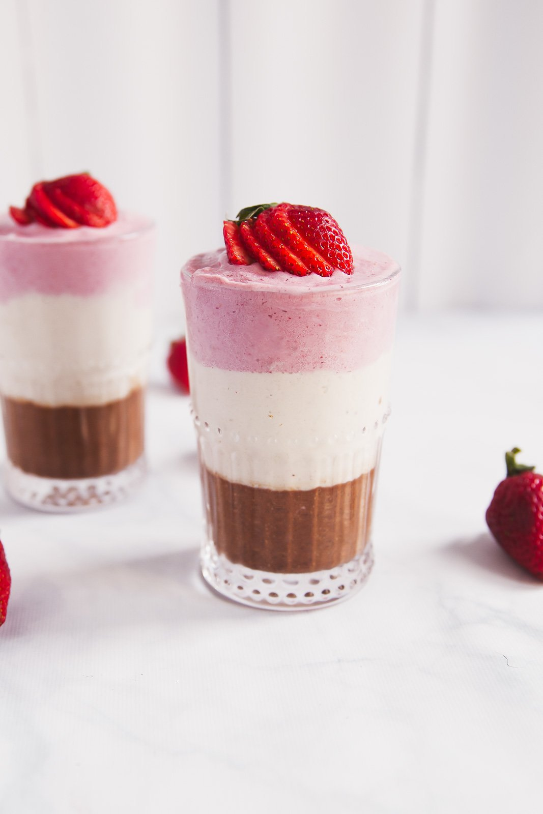 Banana Split Protein Smoothie that tastes like ice cream! So good topped with coconut whipped cream or peanut butter.